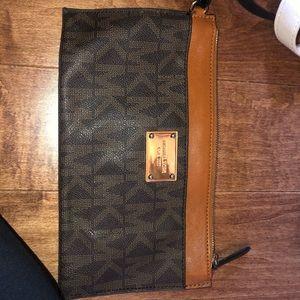 Tan and brown Micheal Kors Wallet wristlet